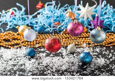 Colorful Christmas balls on blurred shiny background