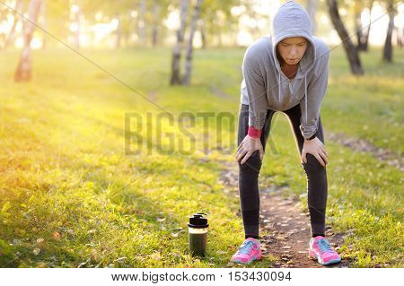 Woman Having A Rest After Hard Workout On A Sports Field.