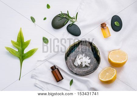 Alternative Medicine And Aromatherapy Bottle Of Essential Oil With Fresh Herbal Sage, Rosemary, Lemo