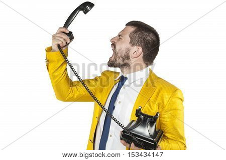 Angry Businessman Screaming To The Telephone Handset