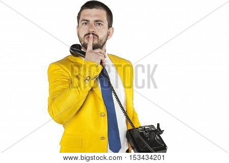 Businessman Does Gesture Of Silence, Talking On The Phone