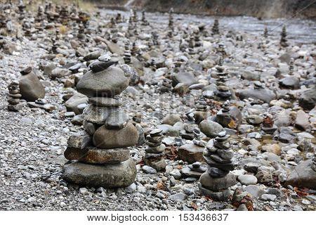 Rock Cairns in Breitach Creek. Allgau. Germany