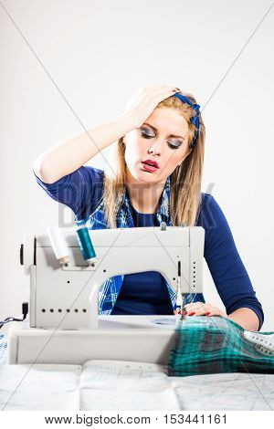 Woman sews and realizes that she made a mistake