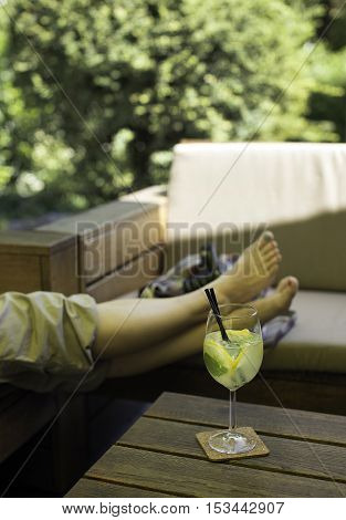 Relaxing on a hot summer day with a cocktail.