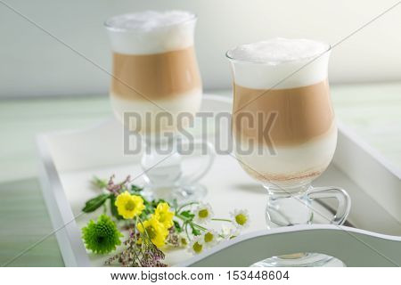 Closeup of two latte coffee in spring