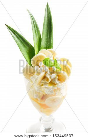 Desserts Made Of Banana Ice Cream And Whipped Cream On White Background