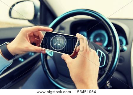transport, business trip, technology and people concept - close up of male hands with musical note icon on smartphone screen in car