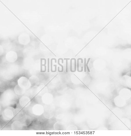 Decorative siver christmas grey background with bokeh lights and snowflakes