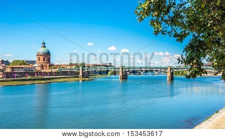 TOULOUSE,FRANCE - AUGUST 30,2016 - Chapel of Saint Joseph with Garonne river in Toulouse. Toulouse is the capital city of the southwestern French department of Haute-Garonne as well as of the Occitanie region.