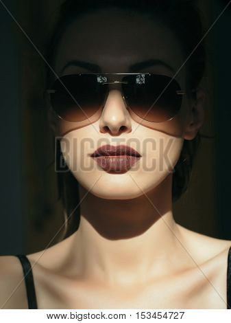 young cute sexy woman or girl portrait with brown lips on pretty face has fashionable makeup in sunglasses sunny day