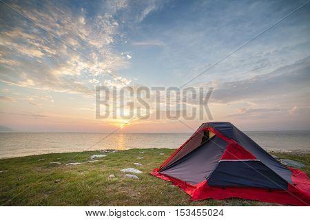 Tent on seashore in the morning. Beautifil sunrise