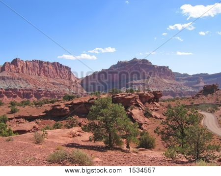 Two Red Wild Mountains And A Twisting Street, Capitol Reef National Park, United States