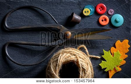 vintage scissors with a roll of twine and buttons