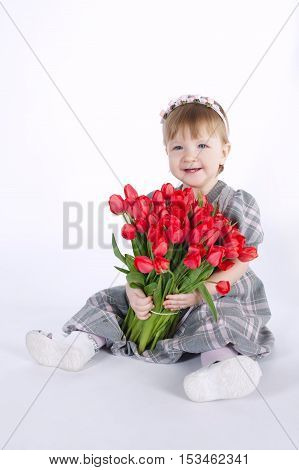 photo of beautiful girl with big bouquet of tulips