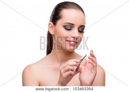 Young woman with scissors for nails isolated on white