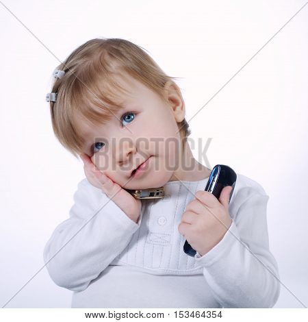 little funny girl with two mobile phones on white