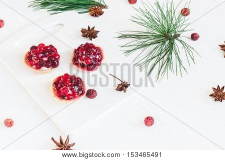 Christmas composition. Christmas dessert of cranberries anise star. pine branches.