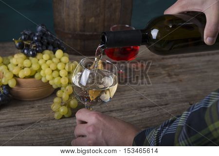 pouring red wine on background, wineglass food