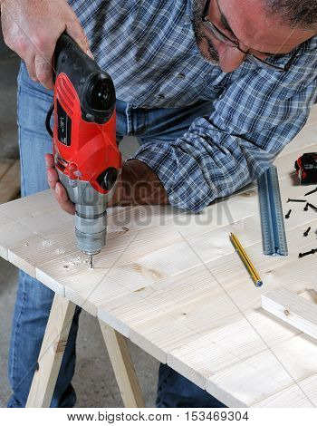 Carpenter At Work On The Wood.