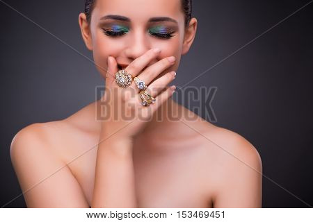 Beautiful woman with jewellery in beauty concept