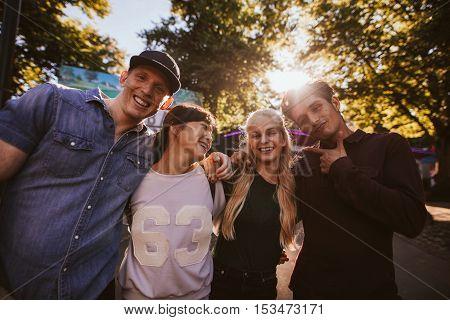 Happy Young Friends Walking In Amusement Park