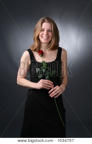 Woman In Black With Rose