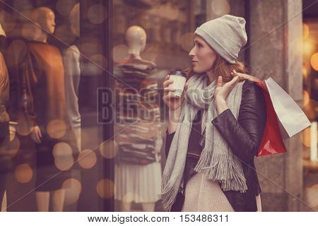 girl buying christmas presents in the city