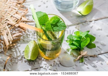 Closeup Of Drink With Lime, Lemon And Sugar
