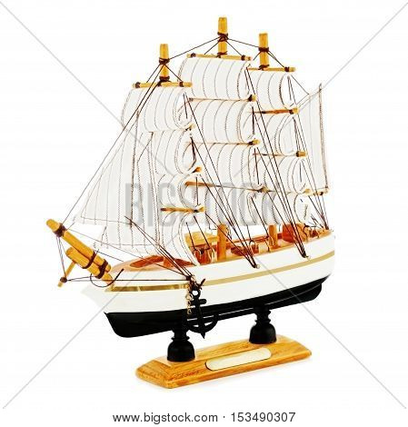 Old sailboat model isolated on white background. Closeup.