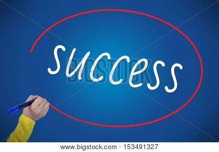 Woman's Hand writing success on blue background. Business technology workout internet concept, young.