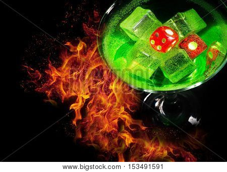 Red dice in a cocktail glass on Fire background. casino series.