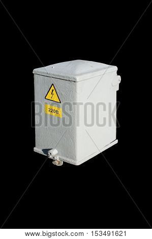 Municipal electrical grey box with 'High voltage' and '220V' signs isolated on black.