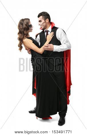 Young couple dressed in vampire costumes for Halloween, isolated on white