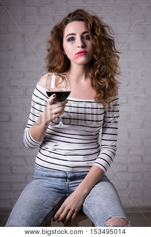 Portrait Of Sad Woman Crying And Drinking Wine