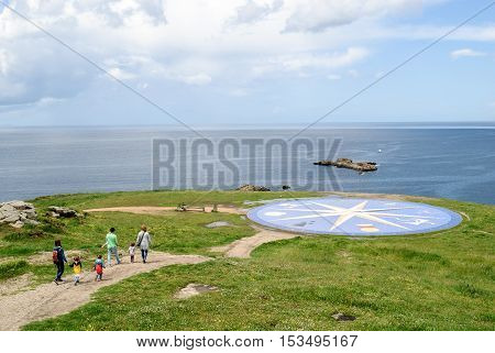 LA CORUNA SPAIN - May 28 2016: Tourist at the Compass Rose (La Rosa de los Vientos) at the Tower of Hercules in La Coruna Spain.