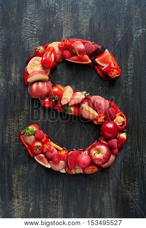 Vegetable letters formed from red fruits produce, overhead flatlay series