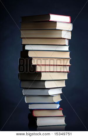 Pile of books on a black background