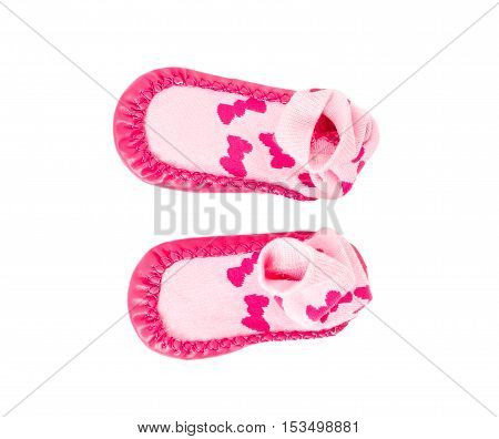Pink soft shoes for babies. Isolated on a white background.