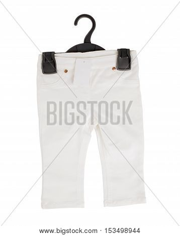 White denim shorts on black plastic hanger with blank label. Isolated on a white background.