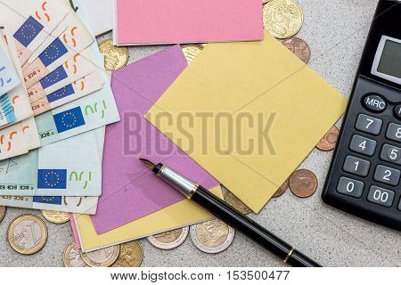 finance concept. euro money with blank pen and calculator