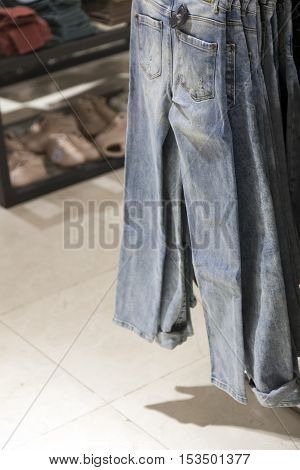 blue jeans hang in store for sale