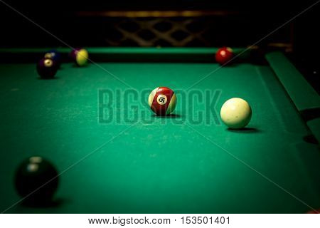 Billiard balls in pool table as sport concept