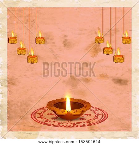 Creative Oil Lamp (Diya) with rangoli and hanging illuminated candles on vintage background, Greeting Card design for Indian Festival of Lights celebration.