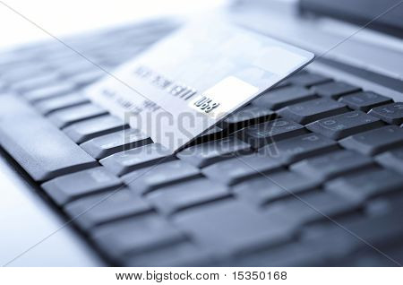 Credit card and laptop. Shallow DOF