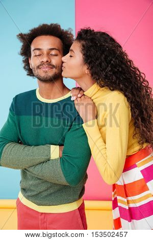 Beautiful tender african young couple standing and kissing