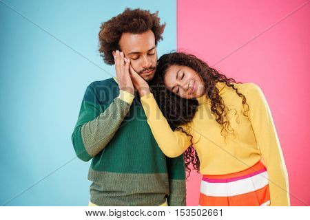 Sensual tired african american young couple standing with eyes closed