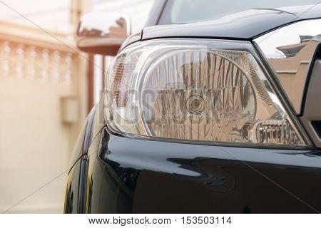 Closeup of car headlight lamp with beautiful sunlight.