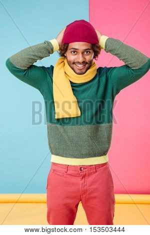 Smiling african american young man wearing hat and scarf
