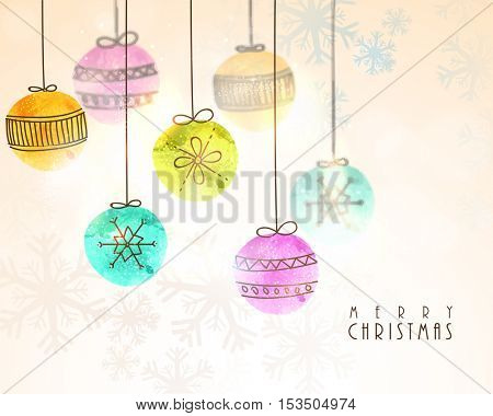 Colorful hanging Xmas Balls on snowflake decorated background for Merry Christmas celebration.