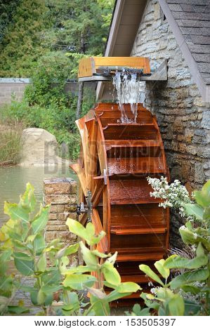 Water wheel on the side of a building